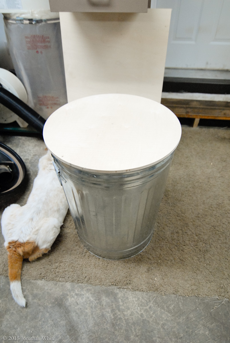 """A piece of ½"""" ply cut just slightly larger than the top of the trashcan."""
